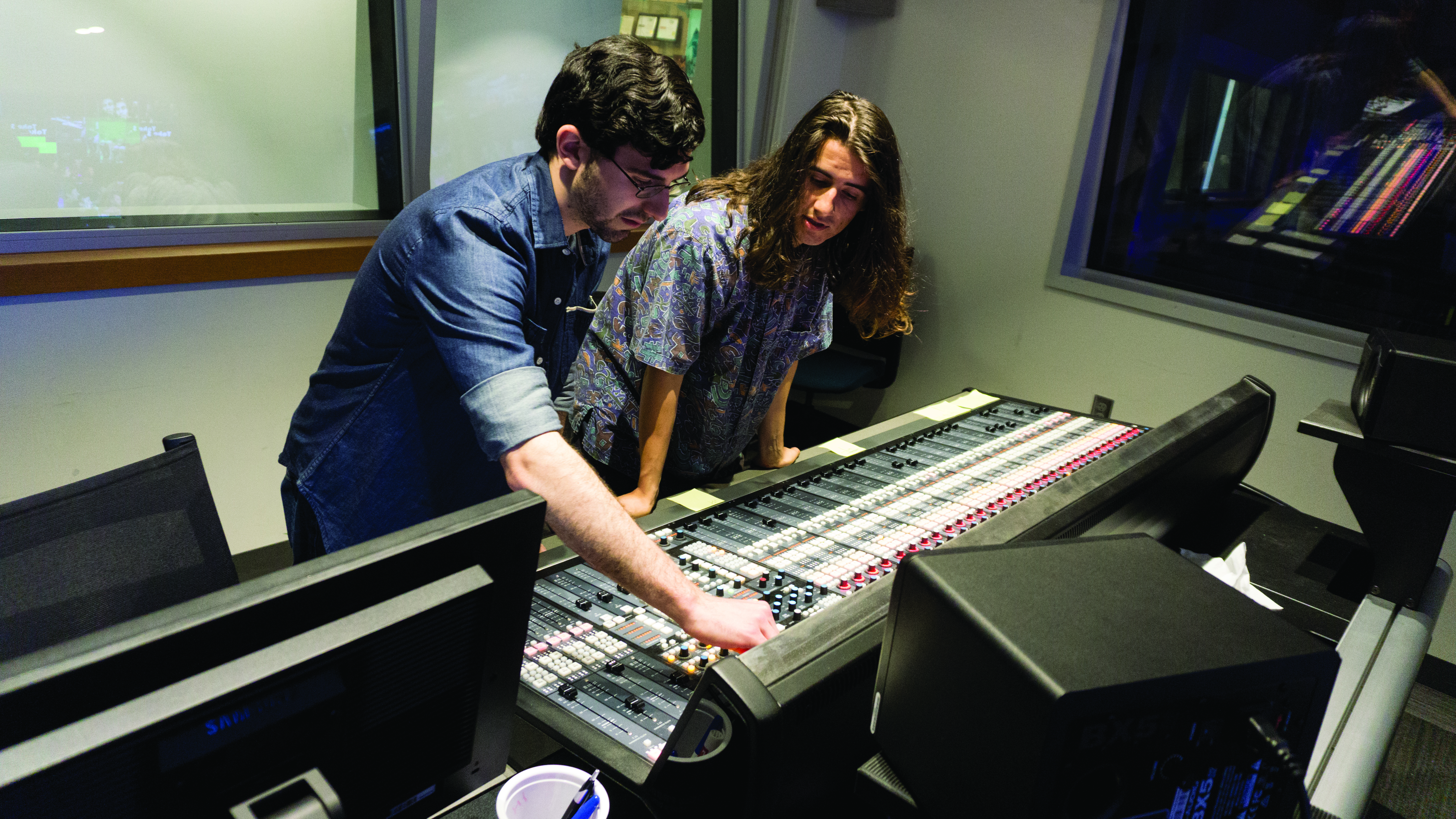 Students working on equipment in the studio